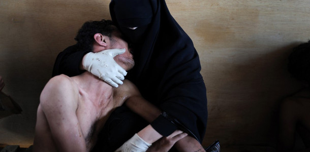 Samiel Aranda, A woman holding a wounded relative in her arms, inside a mosque used as a field hospital by demonstrators against the rule of President Ali Abdullah Saleh, during clashes in Sanaa, Yemen on 15 October 2011.